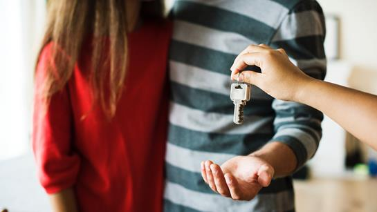 Couple receiving keys to home