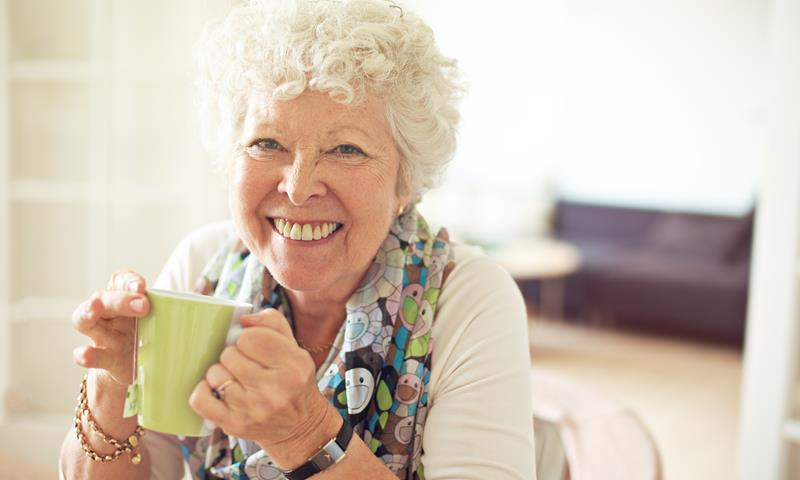 Older Lady Drinking Tea At Home