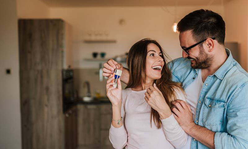 Young Couple With Keys To Home